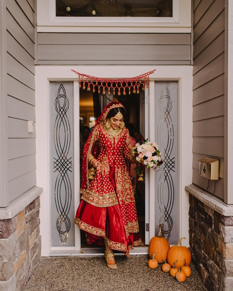 indian bride leaving her house