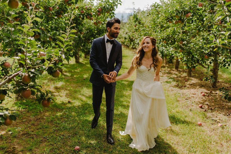 stylish bride and groom in orchard