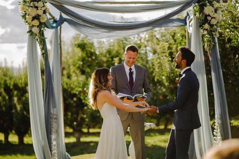 candid orchard wedding ceremony