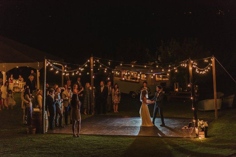 outdoor first dance under globe lights