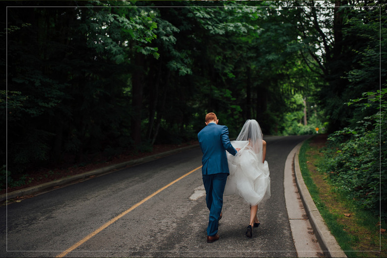 bride and groom walking through stanley park in vancouver on their wedding day
