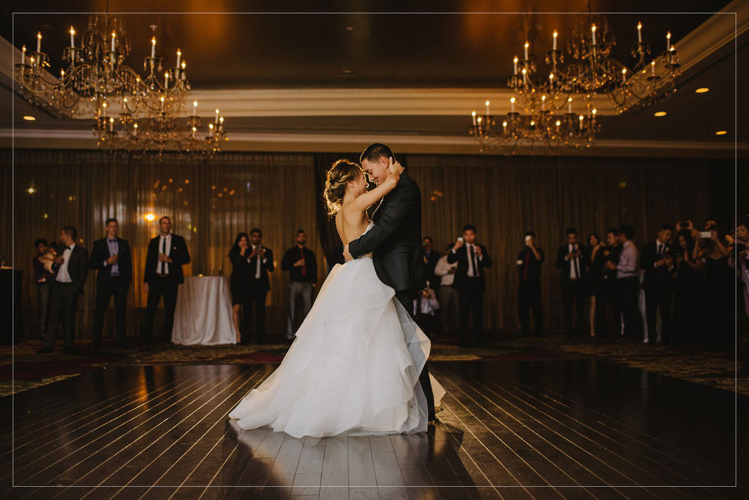 bride and groom dancing in Vancouver hotel ballroom by vancouver photographer mathias fast