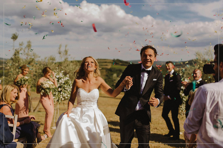 bride and groom exiting ceremony to confetti by Destination wedding photographer mathias fast