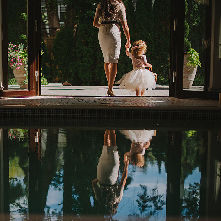 reflection of a flowergirl in the water