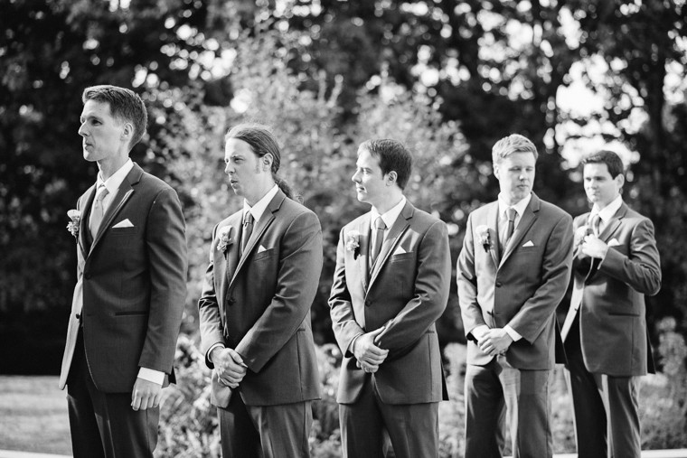 groomsmen waiting to walk down the aisle