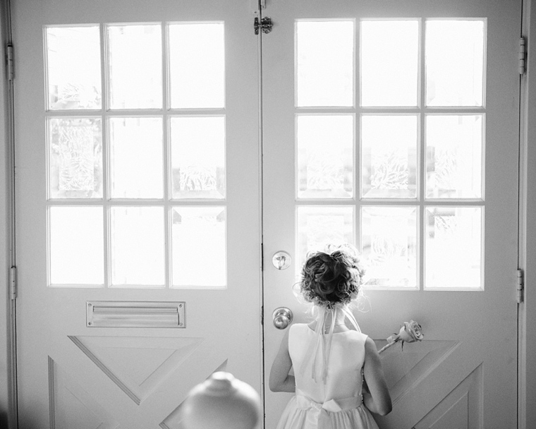 flowergirl looking out the window