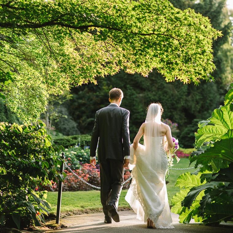 bride and groom walking in queen elizabeth park
