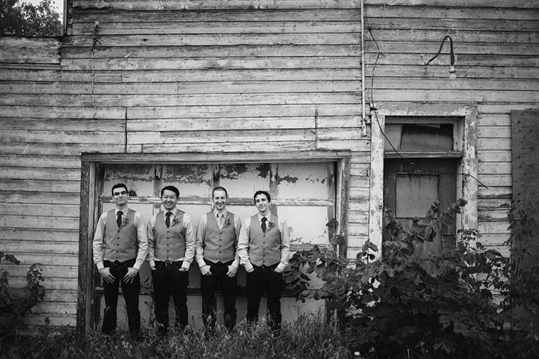 groomsmen in front of run down building