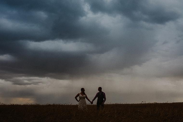 wedding portrait with stormy prairie sky