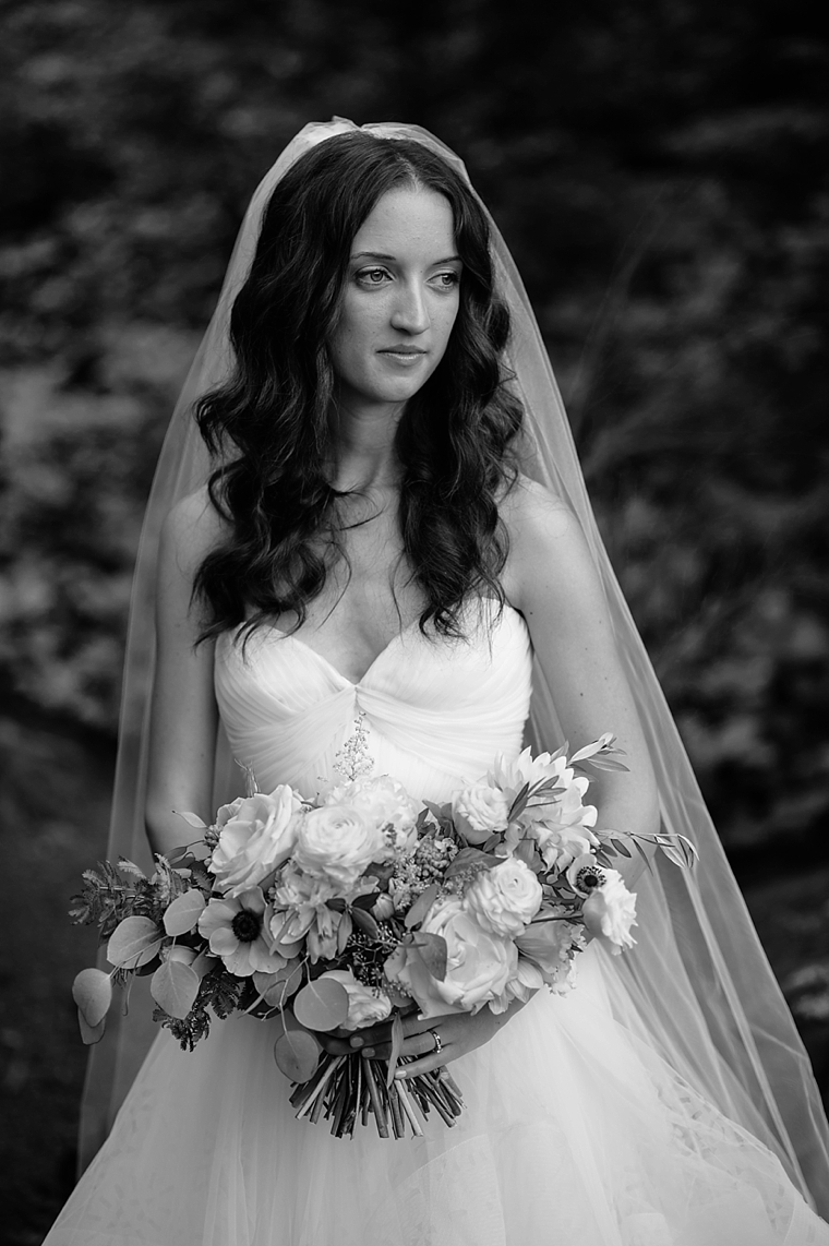 black and white portrait of bride in a forest