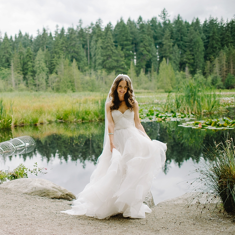 happy bride by forest lake