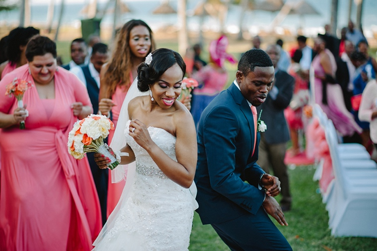 african bride and groom dancing at wedding