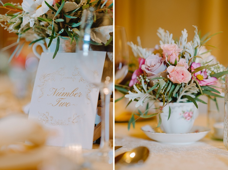 pink flowers in teacup wedding decor