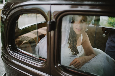 bride looking out of classic car