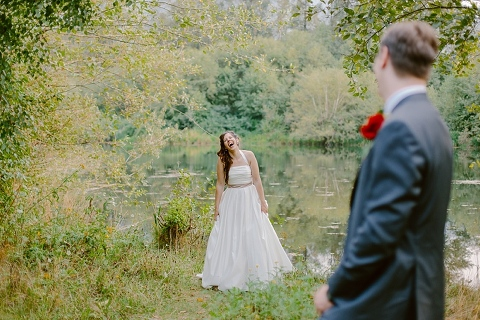 bride laughing in the forest