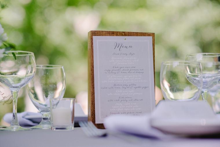 wedding menu on wooden block