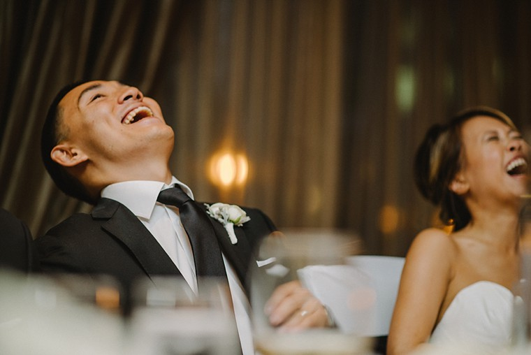 groom laughing during wedding reception