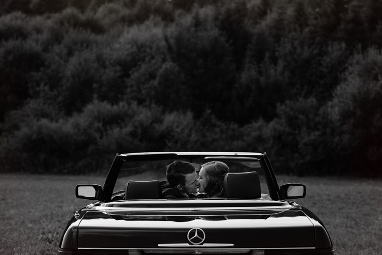 wedding portrait with a convertible in a field