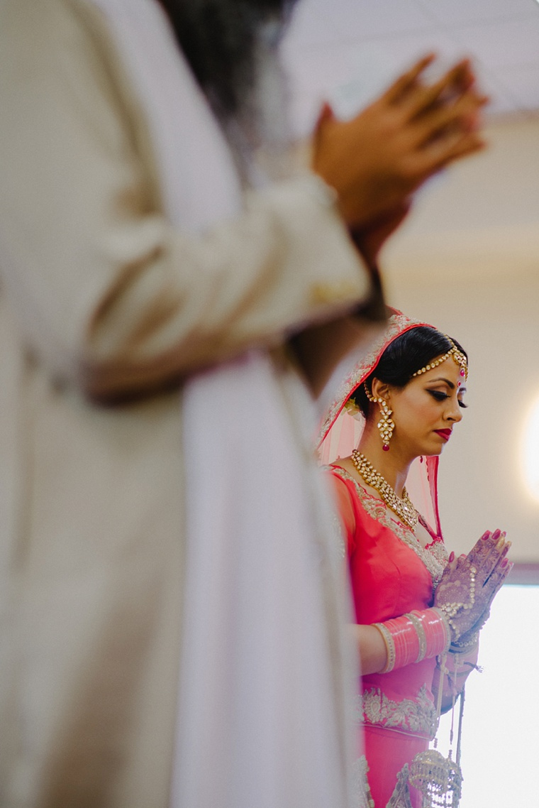 Indian bride praying during wedding ceremony