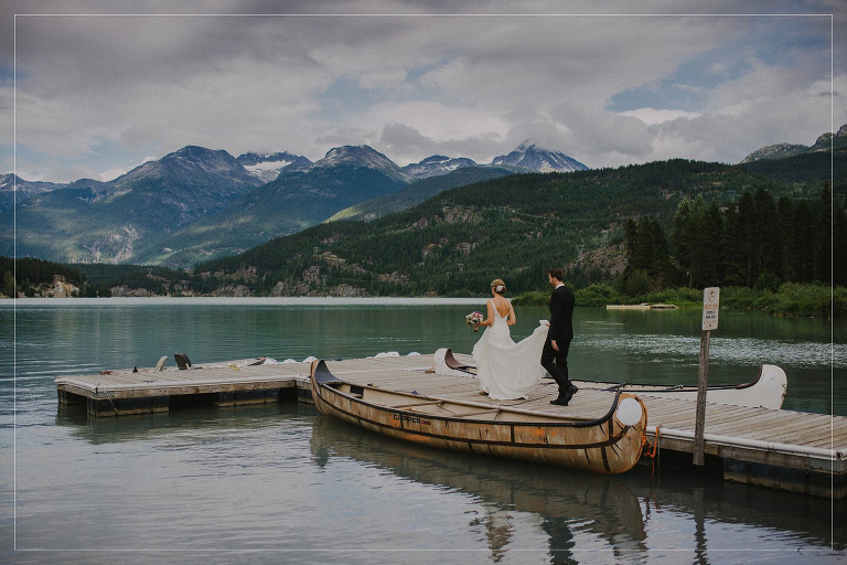 bride and groom walking down a dock in whistler bc on their wedding day