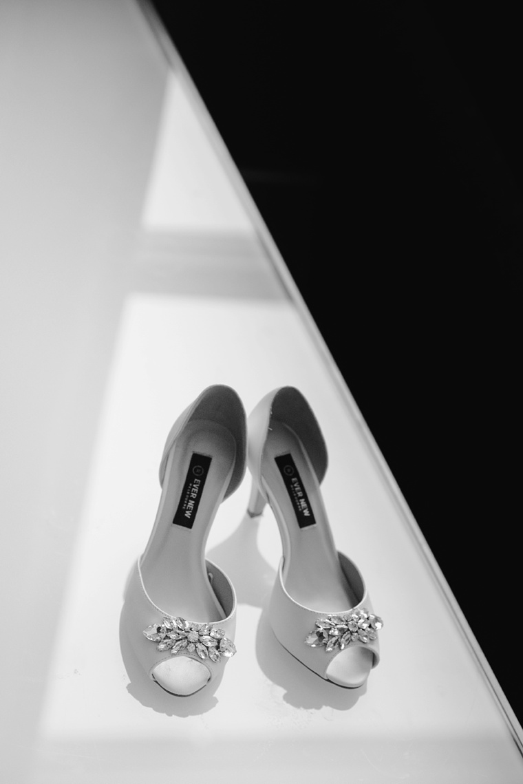 unique black and white photo of wedding shoes