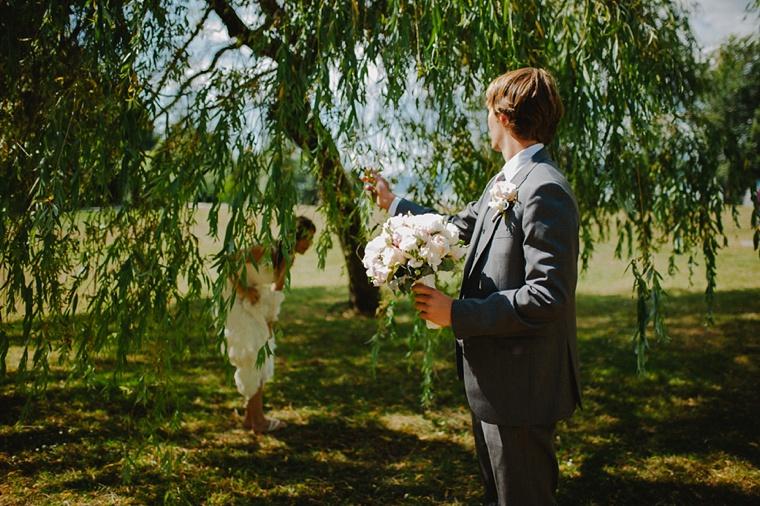 wedding portrait taken under a willow tree in vancouver