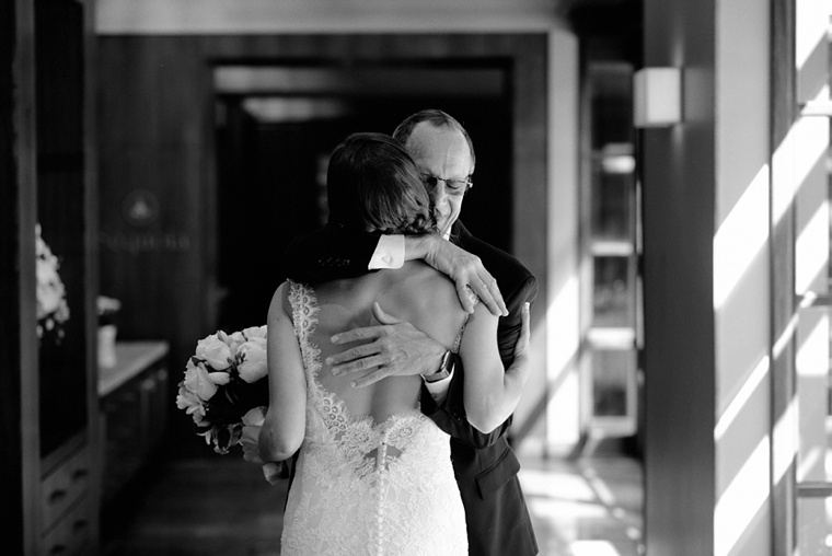 father embracing his daughter before wedding