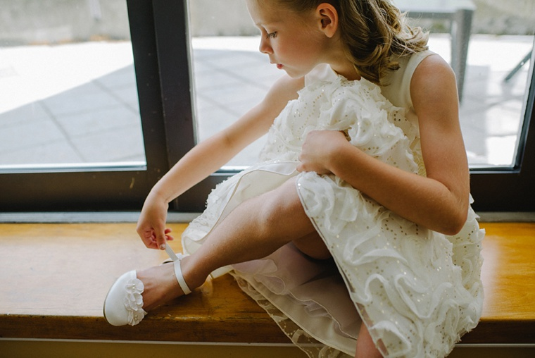 flower girl putting on her shoes