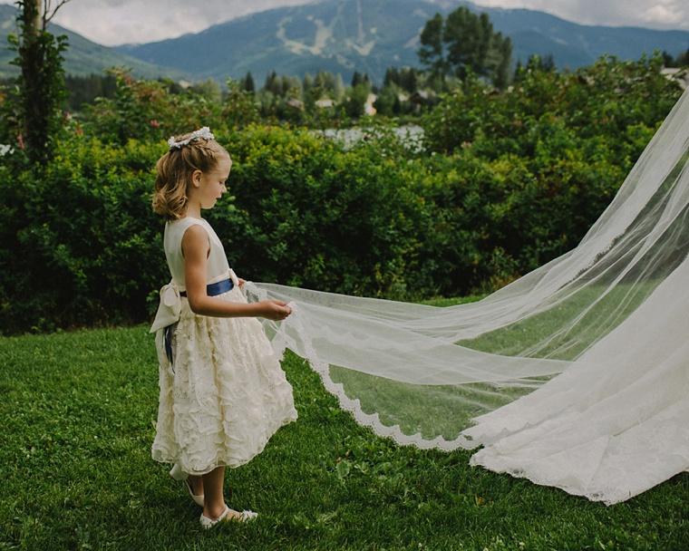 flower girl looking at wedding dress