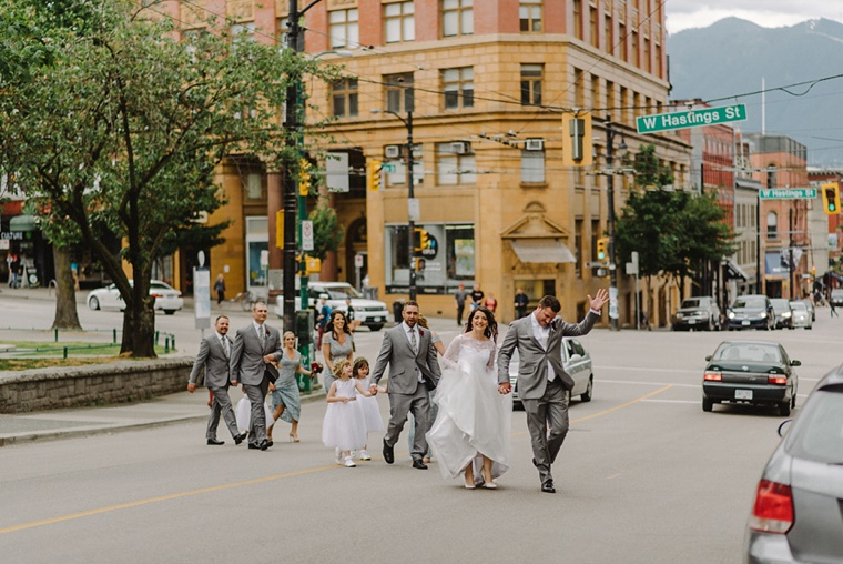 bridal party walking across the road