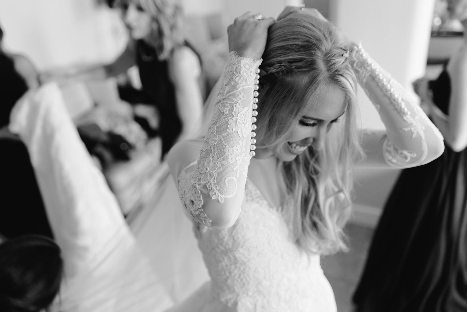 bride putting on her veil