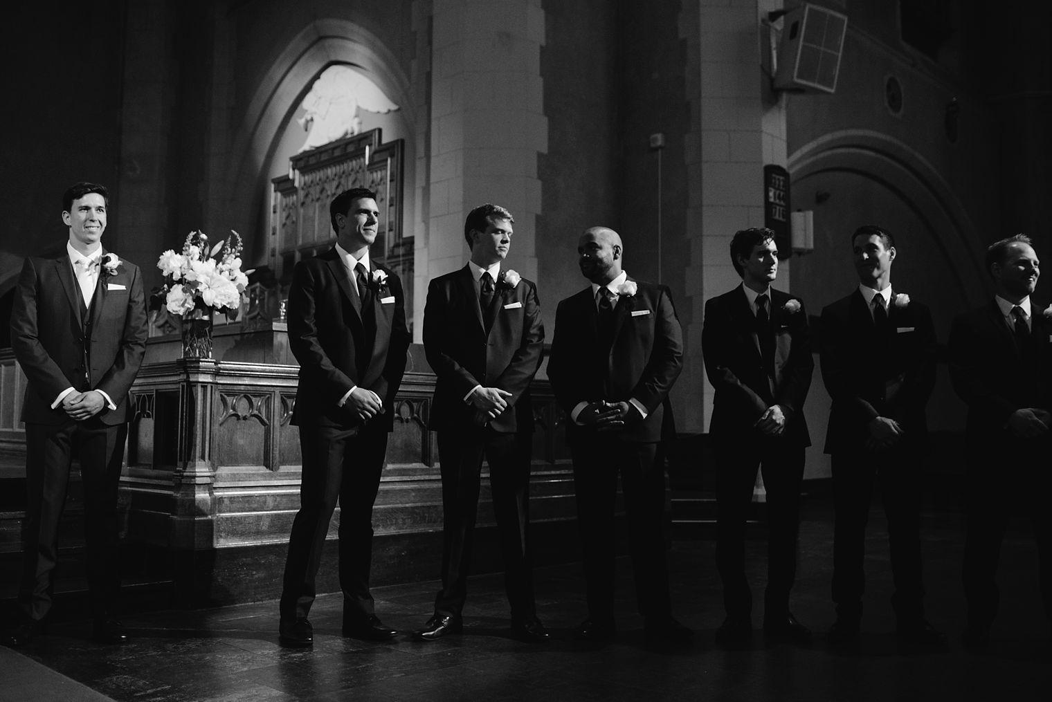 groomsmen waiting during wedding ceremony