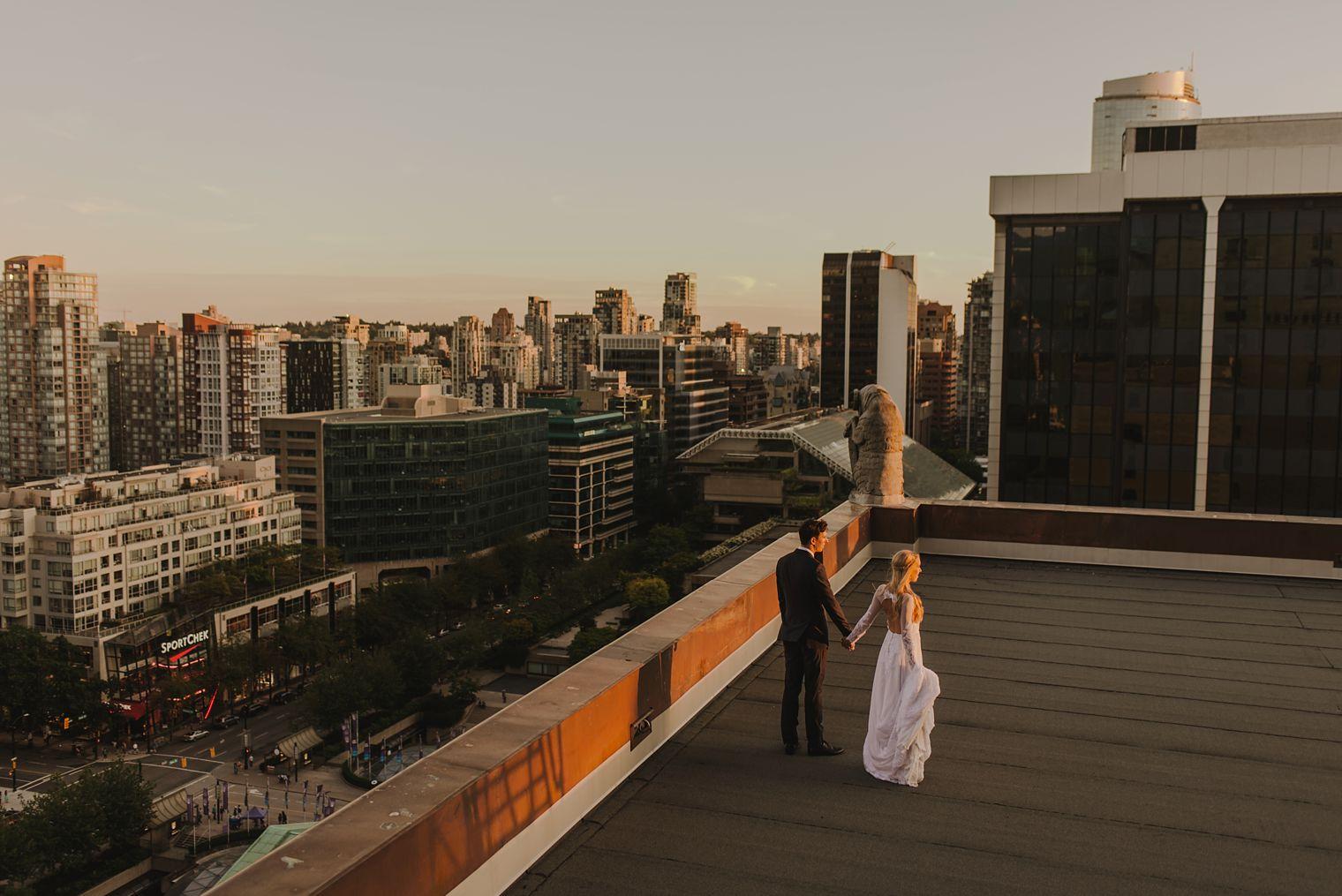 wedding portrait on roof of fairmont hotel vancouver