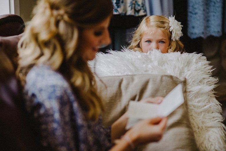 flowergirl looking at bride