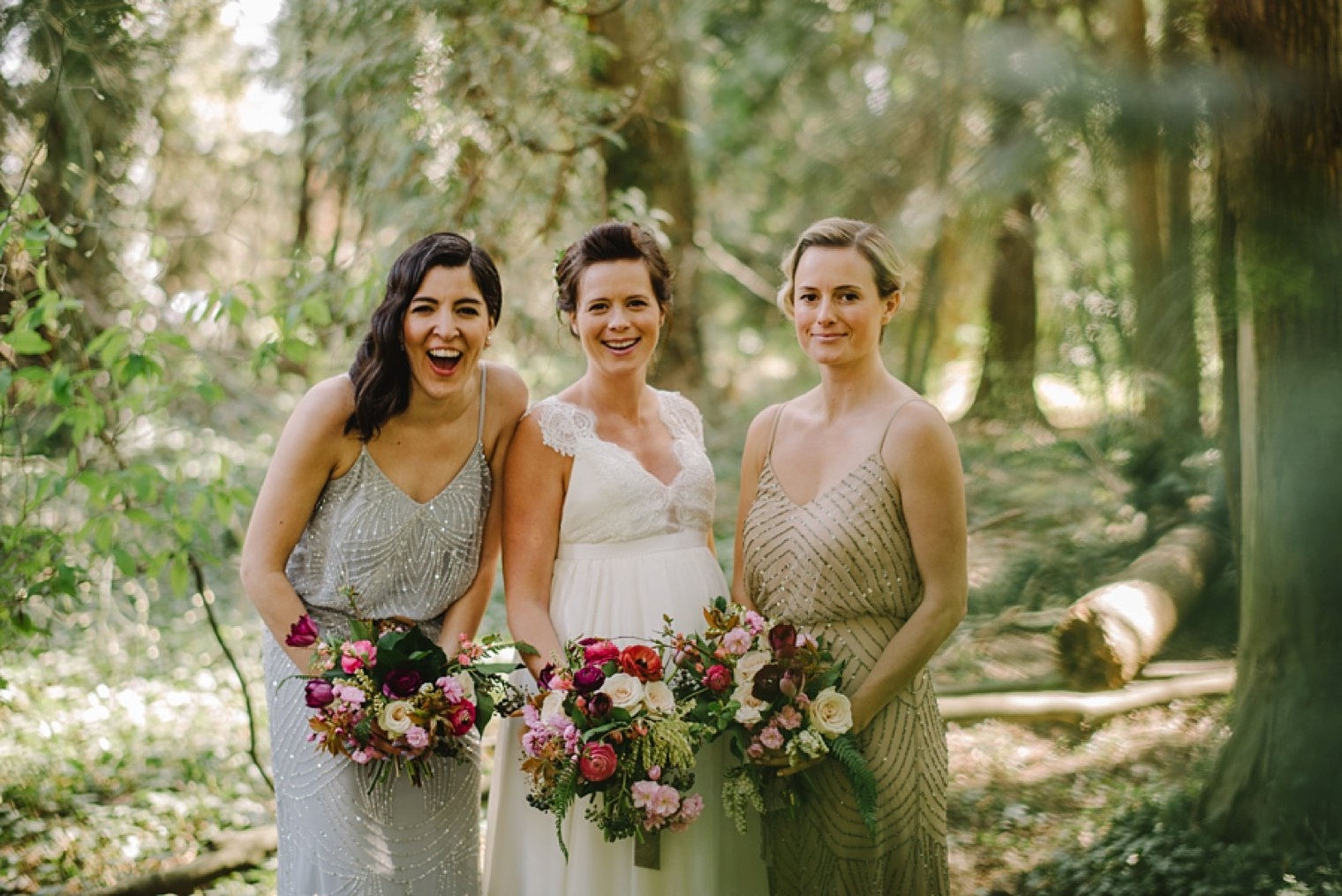 bridesmaids in forest laughing