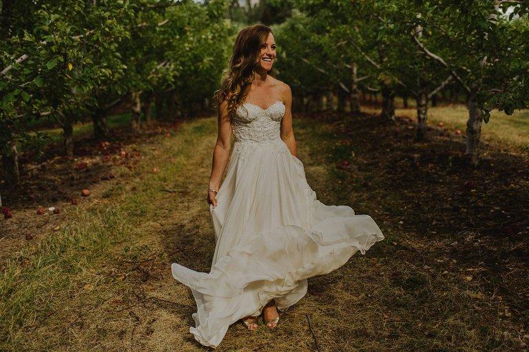 bride dancing in flowy dress