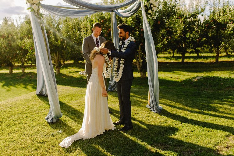 indian wedding ceremony in an orchard