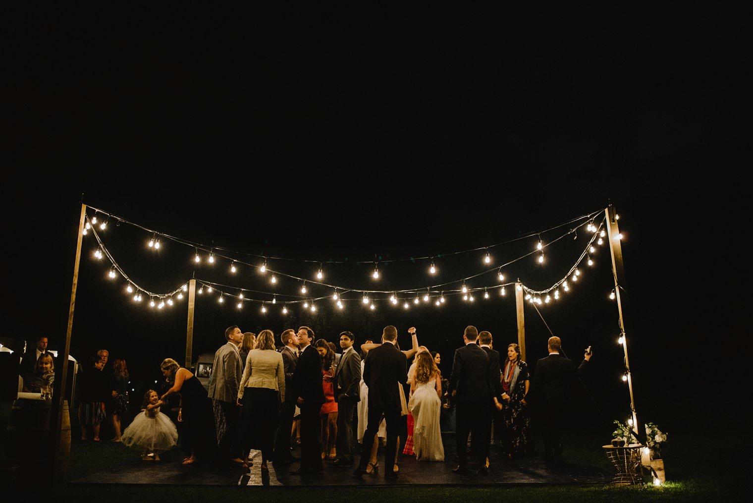 outdoor dance floor with globe lights