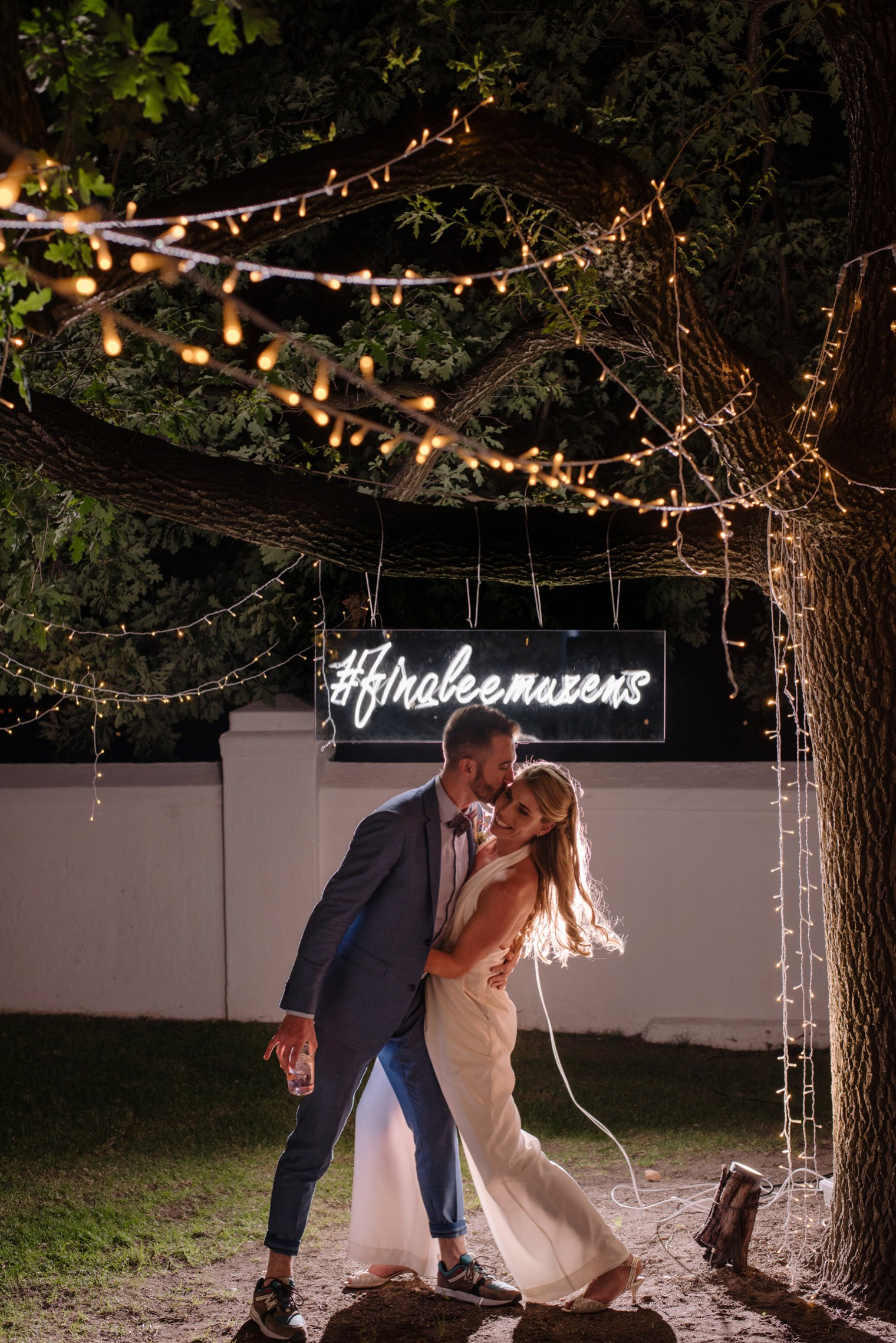 wedding portrait with neon sign