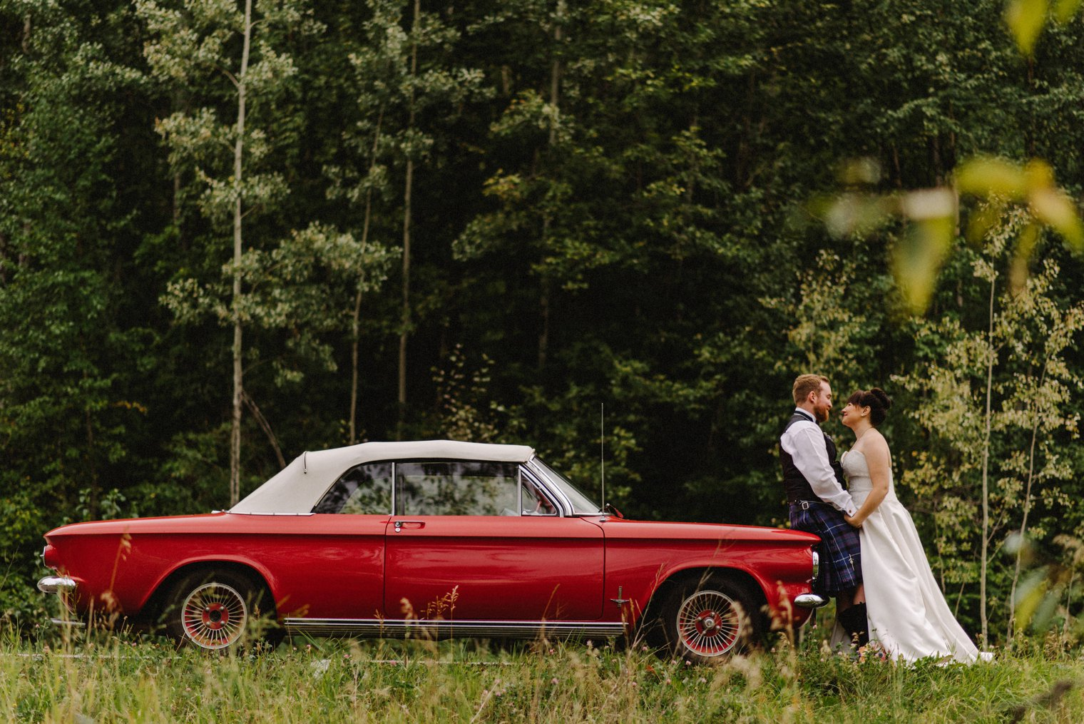 wedding photos with red convertible mustang