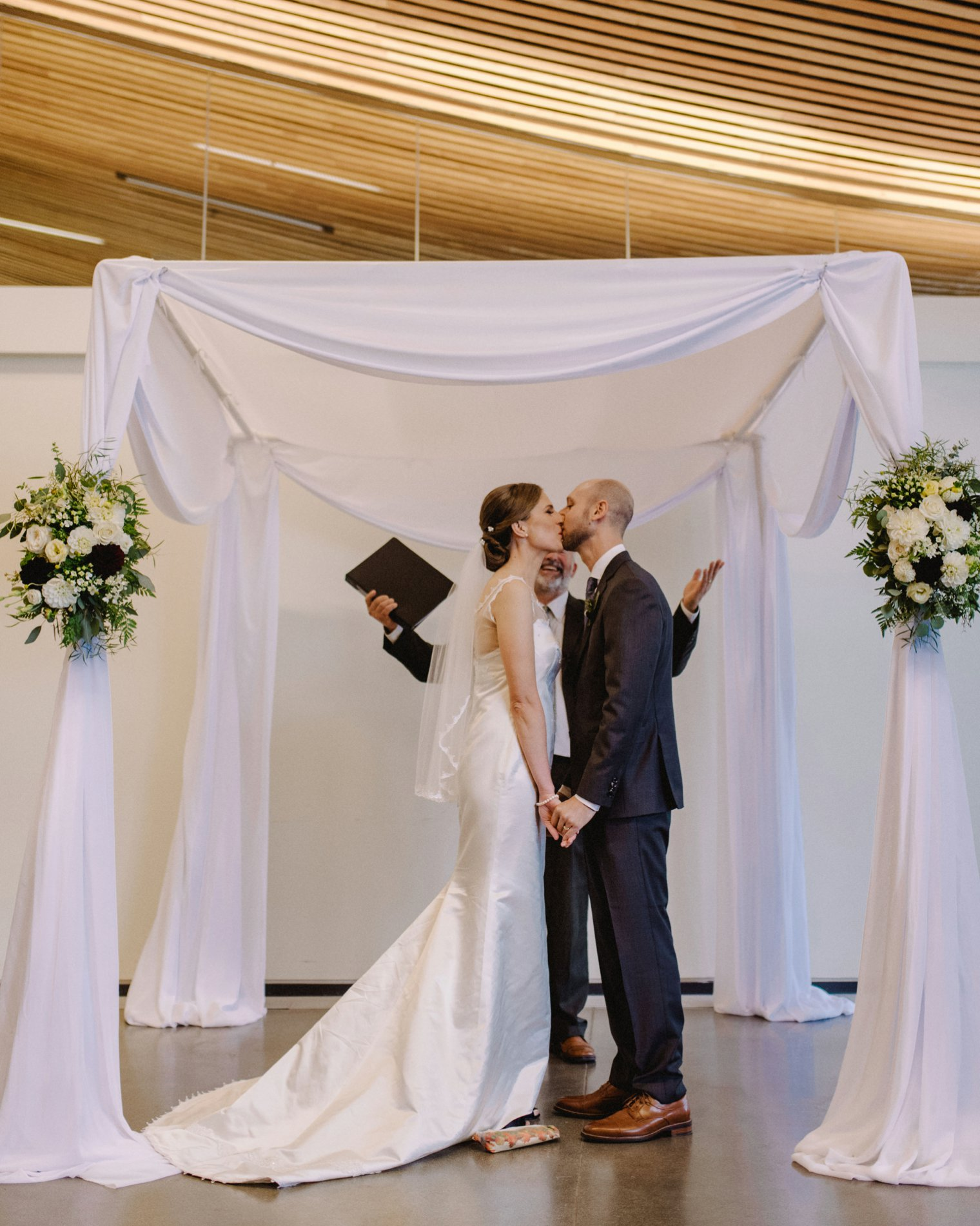 indoor wedding ceremony at vandusen garden in vancouver